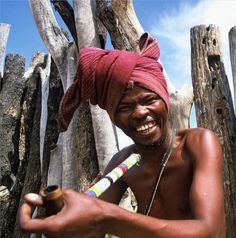 Africa | Smoking from a traditional beaded pipe. South Africa | ©Nelson Mandela Bay Tourism
