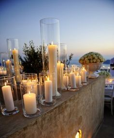 Love all the different size candles-perfect for an outdoor or indoor wedding!