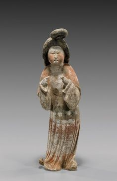 TANG PAINTED POTTERY COURT LADY. Superbly modeled, Chinese Tang Dynasty painted pottery figure of a corpulent court beauty: with upswept hair, finely painted face and in draped robes, with hands gesturing; much original pigments remaining; H: 15 1/2""