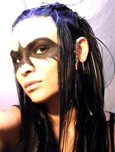 Amazing what face paint and a tribal ear cuff can do.