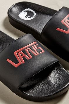 b7b84fb93fc Check out these Vans pool slides featuring a branded foot strap and a  yin-yang