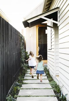 Step inside this peachy keen Melbourne Bungalow - Smart House - Ideas of Smart House - A smart reinterpretation of the past and happy shades take this family home into a bright future. Paver Path, Grass Pavers, Garden Pavers, Walkway, Garden Path, Large Concrete Pavers, Bungalow, Side Yard Landscaping, Landscaping Ideas