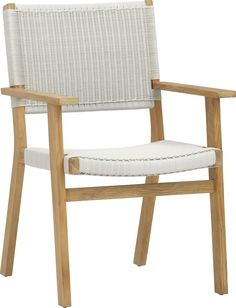 Darwin Dining Chair x6 with accompanying wood table under some kind of shelter from the sun