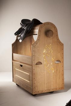 Saddle cart made from massive French oakwood with mahogany inlay and 23.75 carat gold leaf gilding.