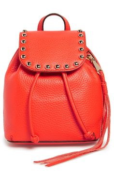 Goldtone dome studs and a trailing side zipper add contemporary-chic appeal to this stylish backpack in poppy red.