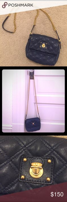 """🎉SALE🎉Marc Jacobs Navy Crossbody Quilted Purse Marc Jacobs Small Quilted Single Crossbody Bag perfect everyday bag! Navy quilted cow leather (softest leather ever) with gold hardware chain approximately 22"""" drop (half chain, 1/2 leather). Two credit card slots inside. Approximately 8""""W x 6""""H x 2""""D. Magnetic snap closure. Marc Jacobs Bags Crossbody Bags"""