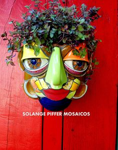 Mosaic pot face - I could view this site for hours. Love her artwork.