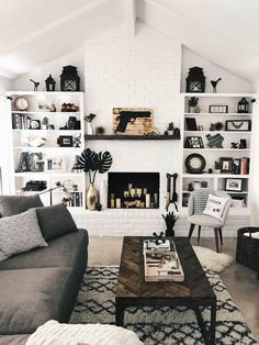 DTKAustin shares DIY tips on how to paint a brick fireplace white and how to brighten up a room up on a budget. | how to paint a brick fireplace | DIY fireplace renovation | renovating a brick fireplace | DIY white brick fireplace | living room decor tips | how to decorate a fireplace || Dressed to Kill