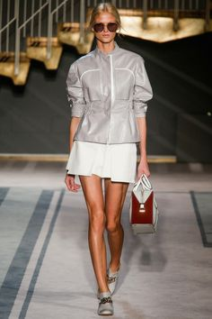 Grey sporty leather jacket with a white skirt by Tod's | Spring 2014 Ready-to-Wear Collection | Style.com