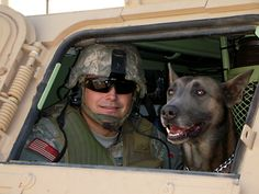 Master Sgt. Craig Young, former member of the 95th Security Forces Squadron, and his then military working dog, Telin, take a break from a patrol while on deployment to Iraq in 2007 and 2008. Telin, a Belgian Malinois and former military working dog at Edwards, deployed three times during his military career.