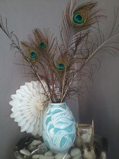 Vintage vase med påfuglfjær