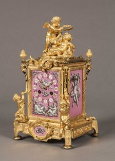 An Antique French Gilt and Porcelain Carriage Clock