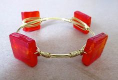 Fire Red Bangle = Heart Throb for our jewelry lovers! This red and gold bangle is hot and looks even better paired with other gold bracelets from www.rocmeout.com!