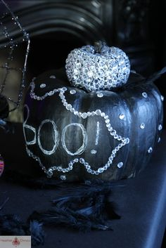 Pin for Later: How to Create the Ultimate Halloween Party Spread  Glamour puss pumpkins bedazzled with crystals, googly eyes, and spray painted with chalkboard paint . . .