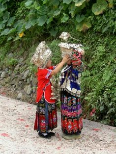 Ethnic Miao children fix their traditional costumes in Guizhou, one of the poorest provinces in China.