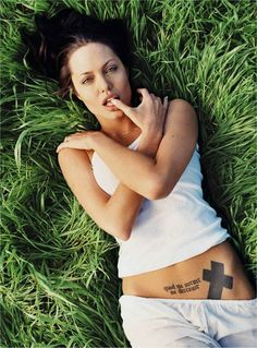 "Angelina Jolie tattoo: ""Quod me nutrit, me destruit"" is a Latin phrase that translates into ""What nourishes me, also destroys me."""