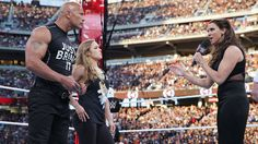 The Rock, Ronda Rousey and Stephanie McMahon at WrestleMania 31