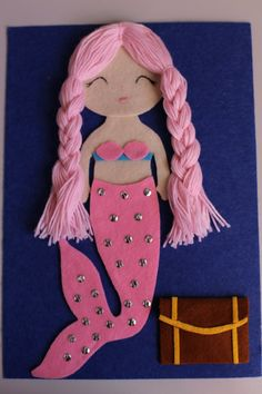 A beautiful mermaid busy book page. She has beautiful 100% baby wool hair that is super soft and ready for your little ones to practice