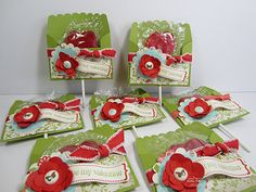 """Valentine Lollipops   Cardstock: Lucky Limeade, Poppy Parade, Everyday Enchantment DSP, Very Vanilla  Stamp Set: P.S. I Love You  Accessories: Scallop Envelope Die-Cut, Floral Fusion Embosslits, Big Shot, Everyday Enchantment Brads, Modern Label Punch, 1-3/8"""" Circle Punch, Scallop Circle Punch, Poppy Parade Ribbon"""