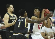 Wichita State forward Zach Brown and Fred VanVleet defend Arizona guard Allonzo Trier during the first half at Dunkin Donuts Arena in Providence on Thursday night.