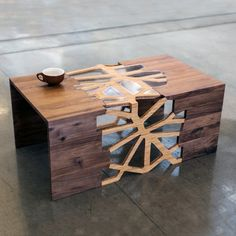 The Branching Table uses traditional Japanese joinery techniques to create an intricate design that does not rely on nails or screws. Designed by Andrei Hakhovich Beautifully contrasting walnut, bamboo and plexiglass. https://www.touchofmodern.com/sales/gradient-matter--2/branching-table