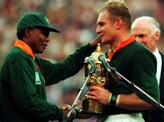 South Africa Captain Francois Pienaar receives the World Cup Trophy with a hand shake from Nelson Mandela the South Print Framed, Poster, Canvas Prints, Puzzles, Photo Gifts and Wall Art South African Rugby, South African News, World Cup Trophy, Rugby World Cup, Nelson Mandela, Suit Stores, Australian Football, World Cup Final, Rugby League