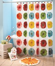 and this is what I am doing to our bathroom. he got the camo I get my gerbera daisies. it's not going to look exactly like this bathroom but all the accents and shower curtains and all are the same. super excited