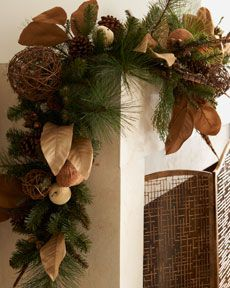 Country Estate Christmas Garland sold at Horchow.com..this is so easy to do with picks from craft store allowing you to change every year and not blow the bank on one look..