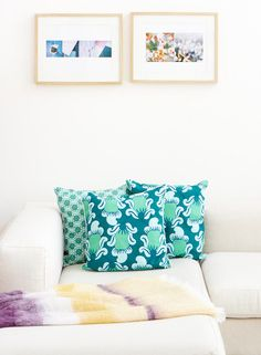 Patterned turquoise couch pillows by Nala Design