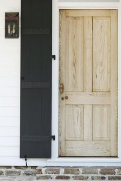 love! love! love! the contrast of unfinished door with the black & white!!- so stripping our doors!