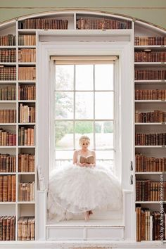 I love this shot with the window and floor-to-ceiling bookcases! Kelly Clarkson knows how to take a fantastic wedding photo.