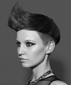 A short brown straight quiff shaved sides avant garde hairstyle
