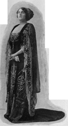 """A gorgeous dress of black satin and tulle with silver and jet embroidery, well suited to the stately figure of the wearer, Miss Julia Neilson, in """"The Popinjay"""""""