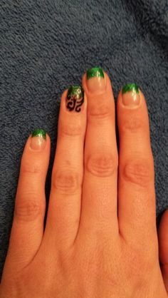 Emerald green gel nails done by Esthetics by Nicole