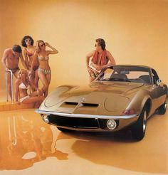 The 1968 Opel GT .. that is a playboy mag in his hand ...