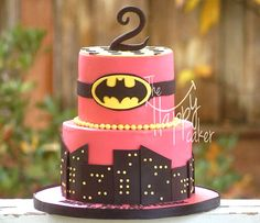 Pink and black Batgirl birthday cake