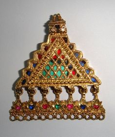Gold and glass-jeweled pendant from Pakistan or Afghanistan.