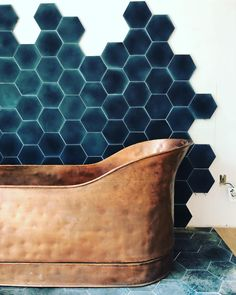 Teal hex tile and amazing hammered copper bath tub