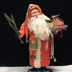 Olde Fashion'  St. Nick~German-style face~wheel toy boat/by: Jean T Littlejohn