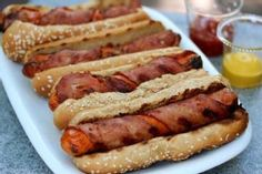 Bacon Wrapped Hot Dog -- taking a great 4th of July food and making it better.. go bacon