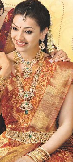 South Indian bride. Temple jewelry. Jhumkis.Red silk kanchipuram sari.Braid with fresh jasmine flowers. Tamil bride. Telugu bride. Kannada bride. Hindu bride. Malayalee bride.Kerala bride.South Indian wedding.Kajal Aggarwal.