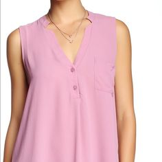 "⚡️Flash Sale⚡️LUSH, Lilas, V-Neck Tank (Juniors) Brand NEW without tag:   Runs big. This is a lavender color not so much purple but that is not an option when picking the color of the blouse                                                    Details: - V-neck - Sleeveless - Partial button front closure - Front patch pocket - Approx. 31"" length - Imported.                                                              Fiber Content: 100% polyester *Runs big. This could fit a size S Lush Tops…"