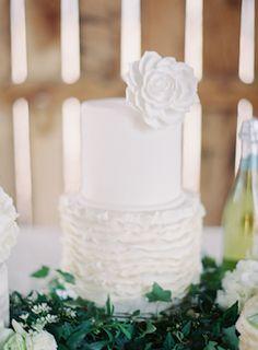 White wedding cake with ruffles | Melanie Gabrielle Photography | see more on: http://burnettsboards.com/2014/12/garden-gunmetal-wedding-inspiration/