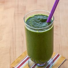 Recipe for a healthy green smoothie with kale, spinach, parsley, cilantro, pear, and coconut milk.