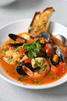 Summer Seafood Stew _ With: firm fish like halibut, talapia, mahi mahi, or salmon, mussels, & arge prawns. A light healthy seafood stew with chorizo sausage. By sylvia fountaine, Feasting at Home Blog June-15-2013.