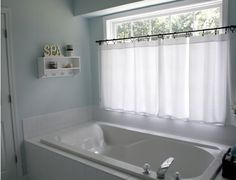 I have a window just like this in my master bath.  These curtains look perfect for privacy and style. (pottery barn)