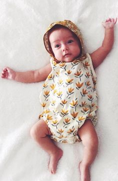 Boho flower child gotta have her florals. Organic buttercup bonnet matching perfectly with baby girl's cool springtime goldenrod romper. Could this outfit be any more summer?? Find floral bonnets at Noble Carriage <3