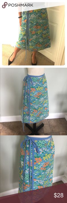 Vintage 70's Reversible Wrap Skirt Super cute vintage 70's wrap shirt.Ties at the side and can fit a Sz 4to 8.Nice vintage condition.Small stain on the blue side.Didnt try to remove and isn't really noticeable. Vintage Skirts A-Line or Full