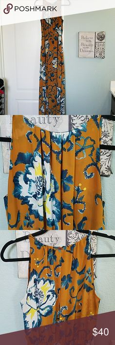 H&M   Floral Maxi Halter Style Maxi .                                                           Gold clasp with an open exposed back (you can wear a tank under for modesty). Two slits on side that go to the knee.  Elastic Waist.  Colors are beautiful! H&M Dresses Maxi