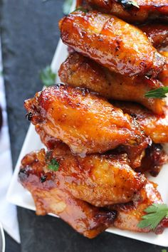 Bourbon Barbecue Wings are marinated and then baked until crispy before they're smothered with spicy, sweet, sticky Bourbon BBQ Sauce. Baked Chicken Wings, Baked Chicken Recipes, Meat Recipes, Appetizer Recipes, Cooking Recipes, Healthy Recipes, Barbecue Recipes, Barbecue Sauce, Bbq Chicken